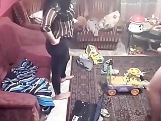 Spy camera records couple caught fucking in the living room.